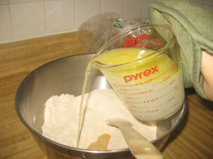 adding water and butter to flour